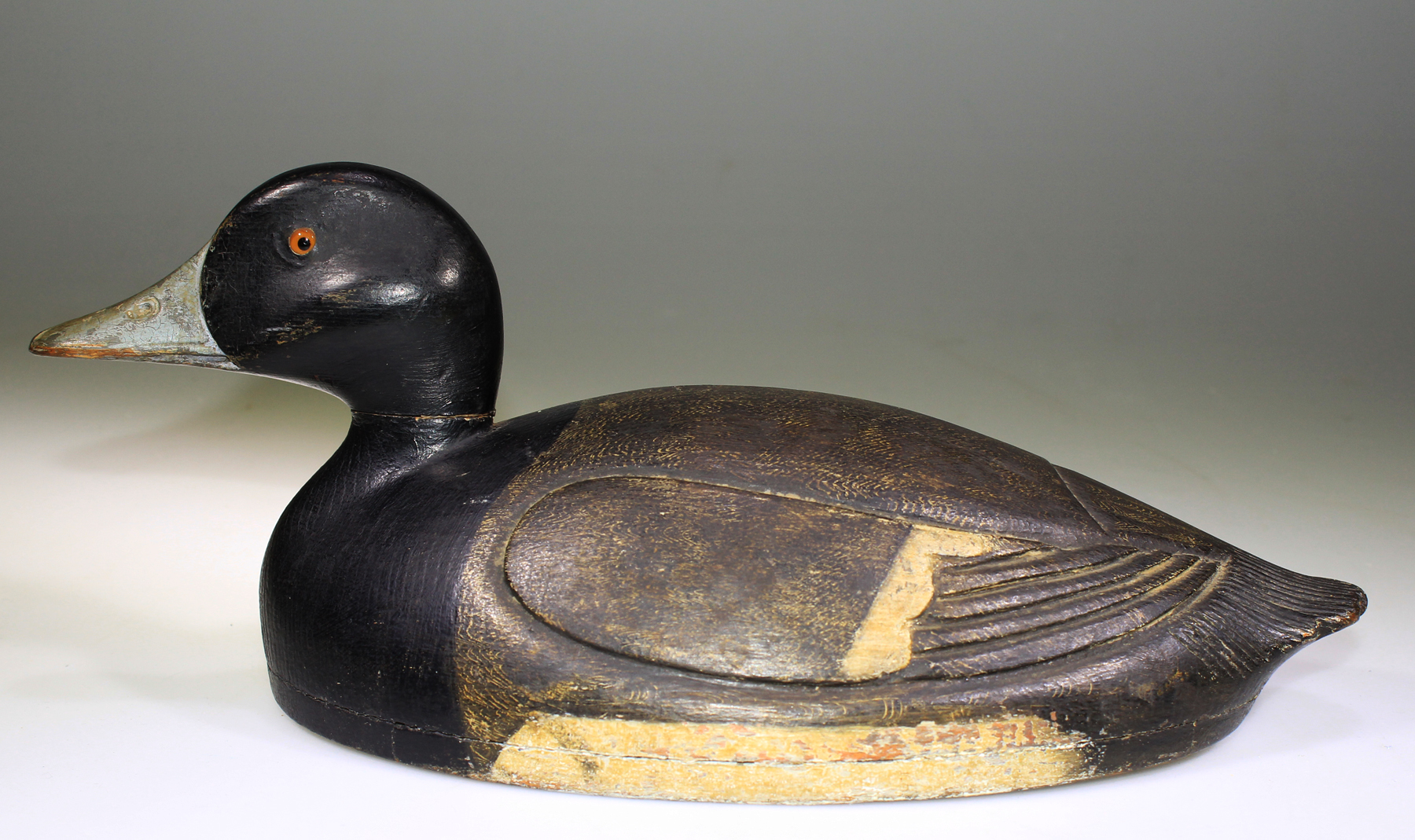 EXCEPTIONNAL HOLLOW BLUEBILL DECOY CARVED BY BUCK CRAWFORD (1897-1958)