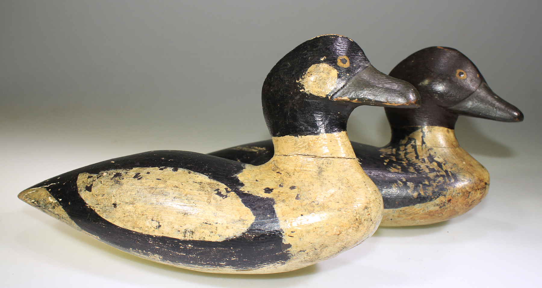 NICE PAIR OF GOLDENEYE DECOYS CARVED BY SAM HUTCHINS